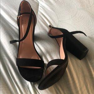 Black high block heel pumps